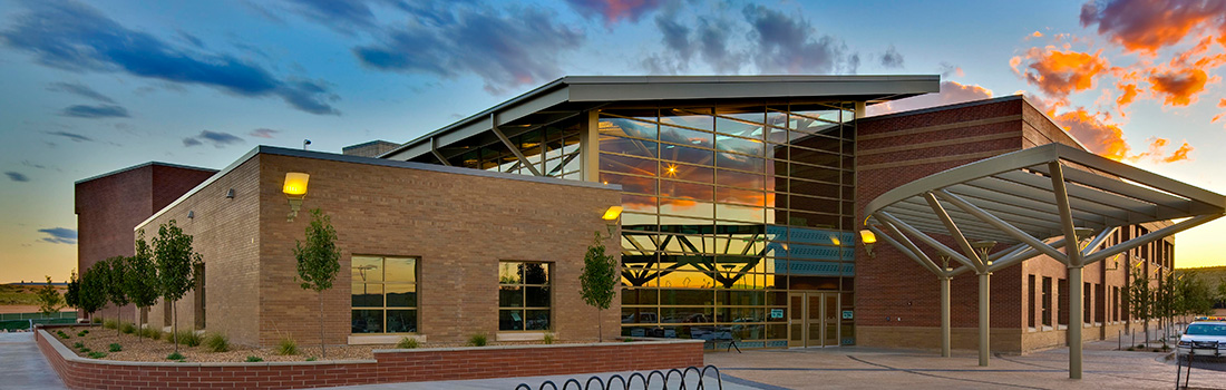 Front of a building on the Rio Rancho campus at sunset.